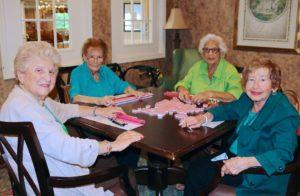 four senior ladies playing game