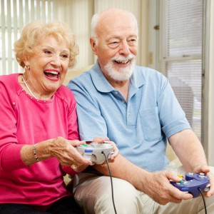 Senior couple playing electronic game