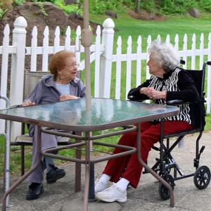 senior ladies talking outside