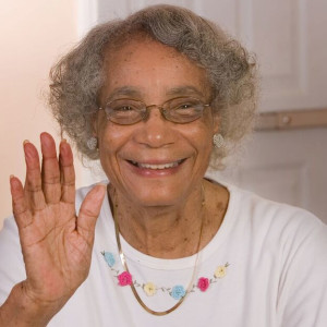 Senior lady smiling and waving