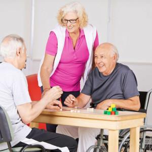 Seniors playing board game